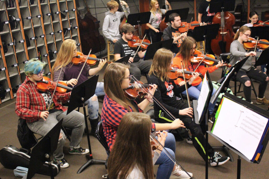JM Strings students rehearse during class.