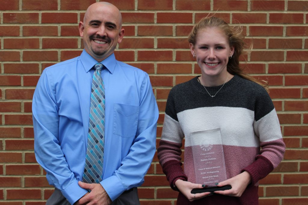Pictured from left: PLTW teacher Gavin Hartle and CTE Student of the Month Kaitlyn Cochran.