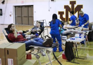 John Marshall High School's Blood Drive Club teamed with the Marshall County Childhood Cancer Awareness Corporation and the Central Blood Bank on Tuesday for a drive in memory of former JM student Abby Frohnapfel.