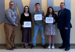 Three JMHS freshman students receive their certificates for K of C Students of the Month